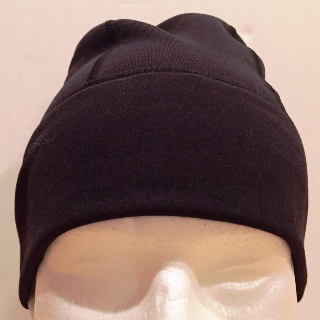 A close-fitting performance beanie perfect worn alone or underneath a helmet for added warmth.